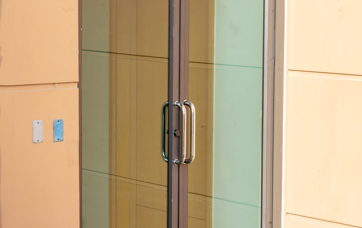 glass door close for exit to outside and light orange wall